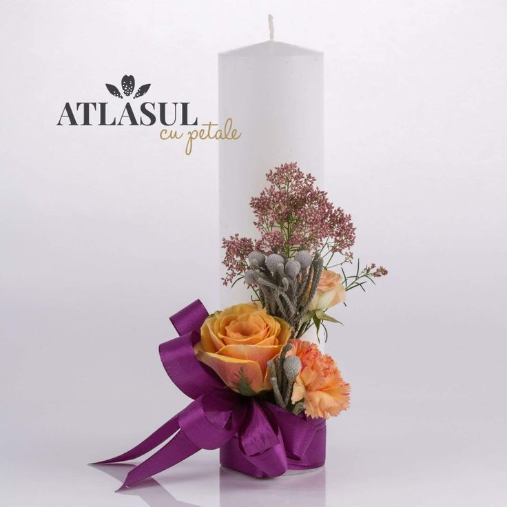 Candle with orange roses