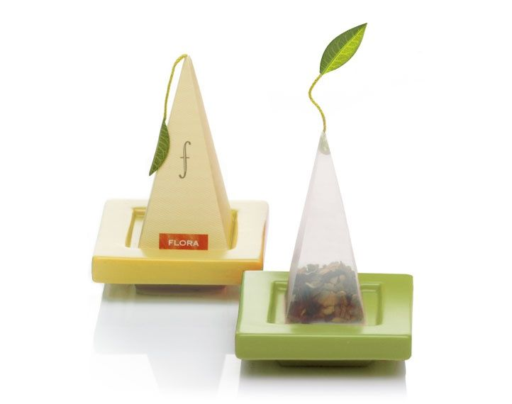 Tea Trays - Our set of ceramic tea trays offer a festive presentation for serving our Silken Tea Infusers. Return infusers to these trays to catch the drips. Each box contains two trays.