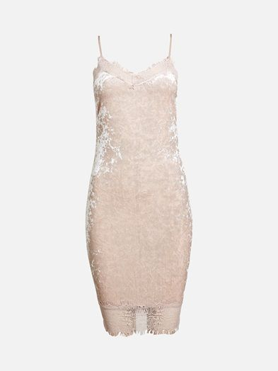 Narrow fit velour dress with lace trim at top and bottom. Zipper in the back.  Rosa