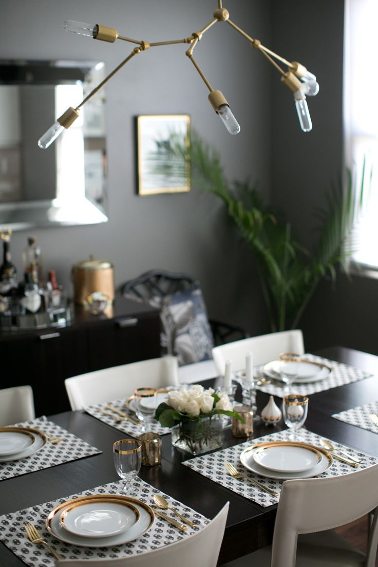 a gray black dining room with gold accents - Dining Room Table Settings