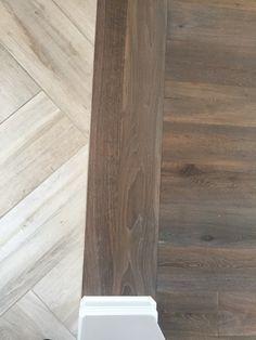 floor transition laminate to herringbone tile pattern foyer to main floor transition - Foyer Tile Design Ideas