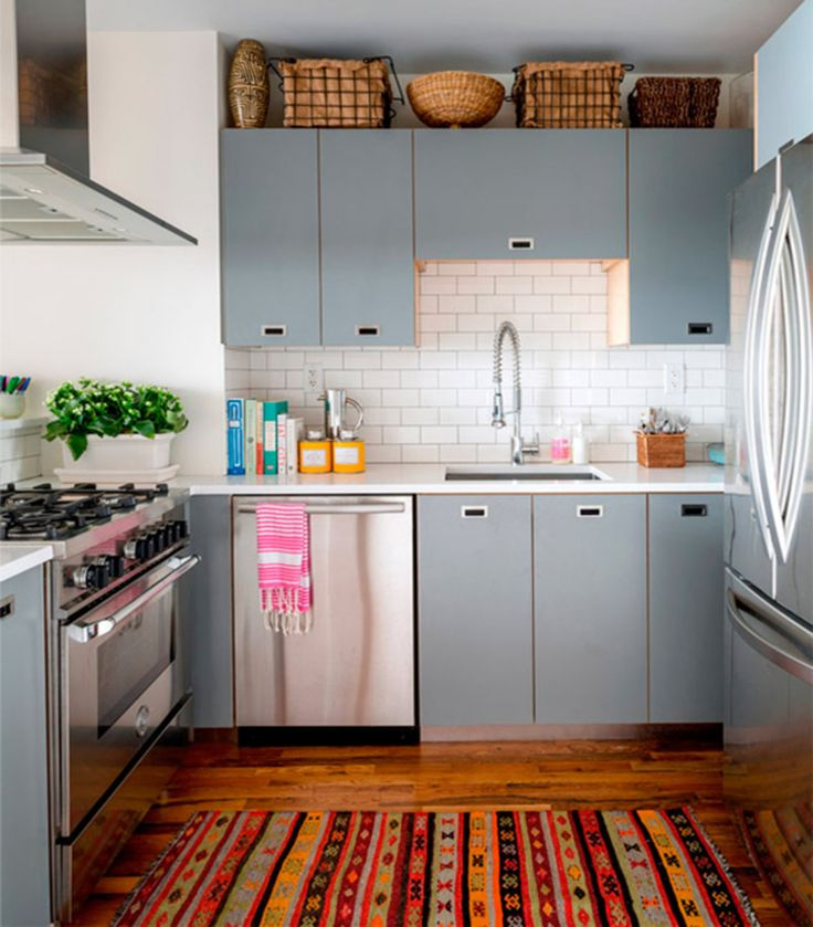 woven baskets, blue grey cabinets, kilim rug