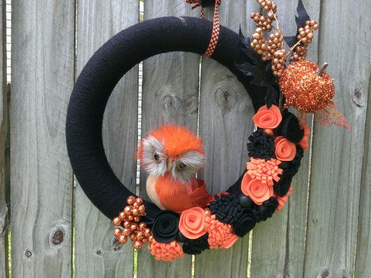 Halloween Yarn Wreath, Fall Yarn Wreath, Owl Wreath--Halloween Black Yarn Wreath with Feather Owl, Felt Flowers, Pumpkin and Berries by YourFourSeasonsDecor on Etsy https://www.etsy.com/listing/199137892/halloween-yarn-wreath-fall-yarn-wreath