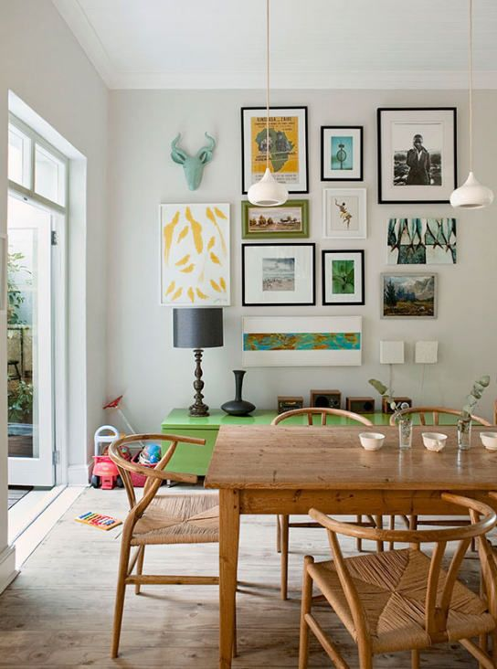 dining room table, green storage chest, multiple artwork on walls - LOVE IT - ...from Russell Smith @ Desire to Inspire...