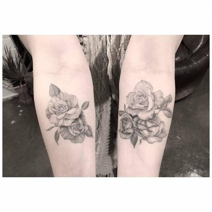 Fine line roses on the inner forearm.