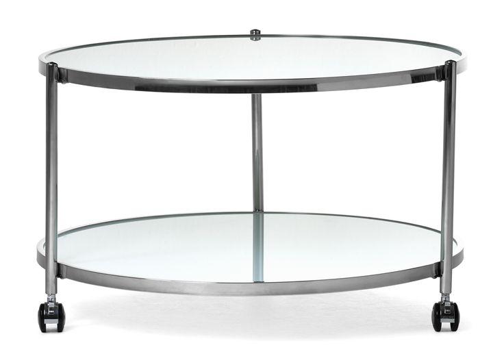 Runt soffbord med hjul som gör bordet lätt att flytta. Underrede i rostfritt stål och skiva i glas. Underhylla i glas med möjligheter till öppen och lättåtkomlig förvaring. Komplettera gärna med sidobord i samma serie.