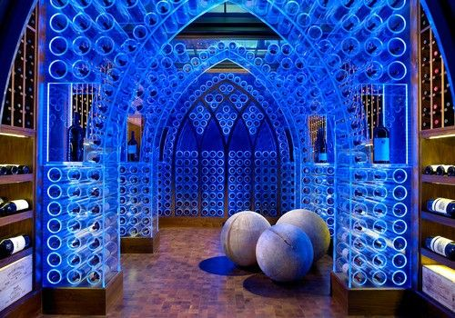Contemporary Pool House and Wine Cellar This has to be one of the most elaborate and creative cellars we've seen, with acrylic wine racks and blue LED lighting. | #winecellar #winestorage