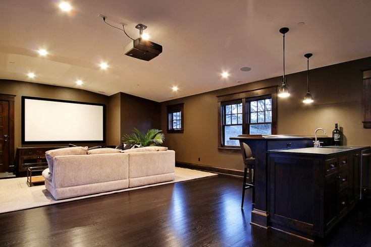 nicely designed basement floors hardwood floor sofa pillows drawers lights projector home theater windows hanging lamps of Nicely Designed Basement Floors to be Amazed By