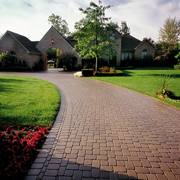 Driveway and walkway landscape. Project application using Romanesque pavers. Color: Romanesque Colonial by Oaks Landscape Products.
