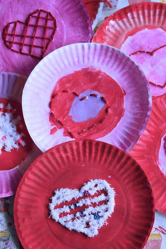 Heart Lacing Activity on Paper Plates - Great Valentines Craft for kids.  Helpful activity to teach early sewing skills and develop fine motor skills - Happy Hooligans