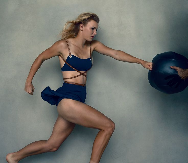 """""""She was really there for me when I needed her the most,"""" says Caroline Wozniacki of Williams. Michael Kors indigo belted swimsuit. - Photographed by Annie Leibovitz, Vogue, April 2015"""