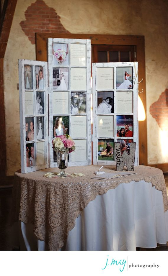 Engagement pics on guest book table at a wedding.