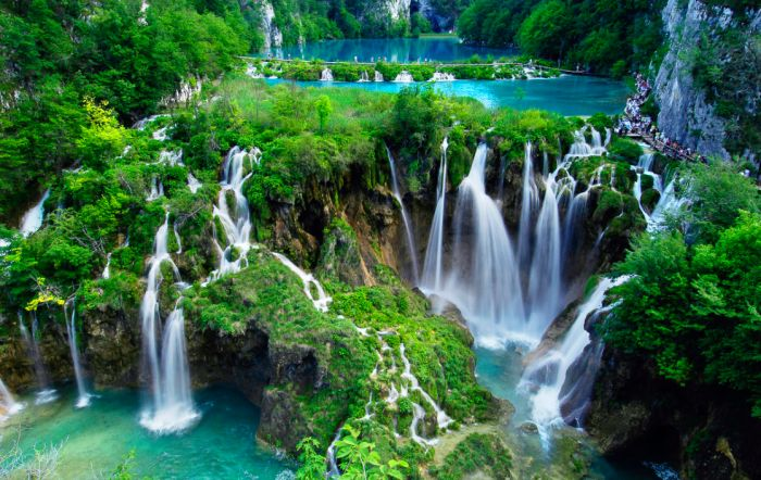 7- Plitvice Falls, Croatia  The Plitvice Falls stand in a perfect contrast to the Natural Park where it is situated. There are over 100 of small waterfalls which will reach from being crystal clear, to azure or to a beautiful turquoise.