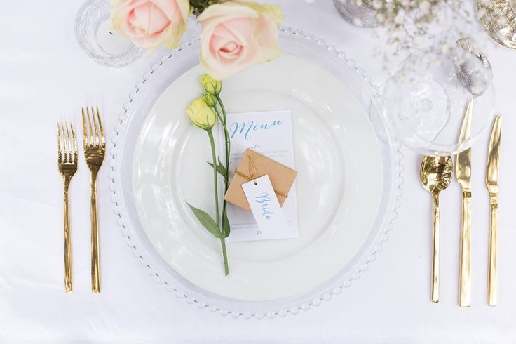 gold cutlery and beaded charger plate Photography by www.facebook.com/LisaFosterPhotography  Stationery by www.facebook.com/inspiredweddings Flowers by www.facebook.com/pages/Flowers-on-Hall-Street Props by www.facebook.com/ThePrettyPropShop Gowns by www.facebook.com/girlmeetsgownpukekohe Desserts by www.facebook.com/LucysCakesandCatering Hair by www.facebook.com/DIOSAhair Venue www.facebook.com/HedgesEstate