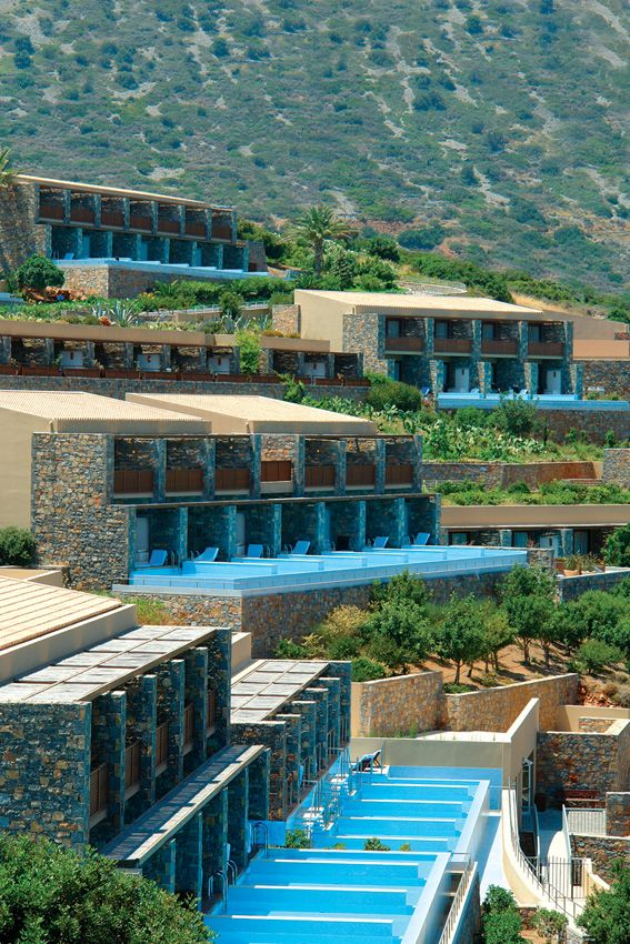 The guest rooms are grouped in clusters of seven and spread around the slope, overlooking the sea. None of the groups is higher than two storeys, ensuring an uninterrupted view to the gulf from each one of them. 106 private pools with their waters sparkling under the hot Cretan sun give a sense of calm and cool.