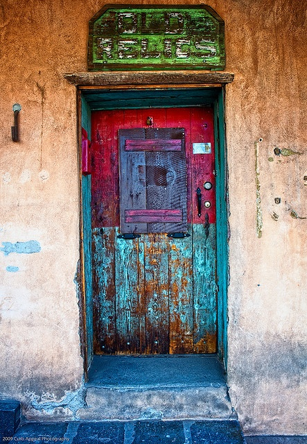 I love New Mexico! Anything goes!.....LOTS OF OLD, DIFFERENT-COLORED CANS OF PAINT IN THE GARAGE AND THE OWNER USED UP THE REMAINDER OF EACH AND EVERY CAN......GREAT GOING FELLOW.....LOVE THE DOOR...........ccp