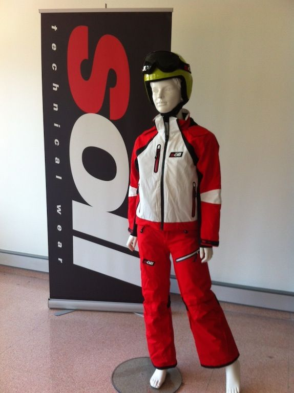 Kids ski wear equipment in color red and white for kids and teens.
