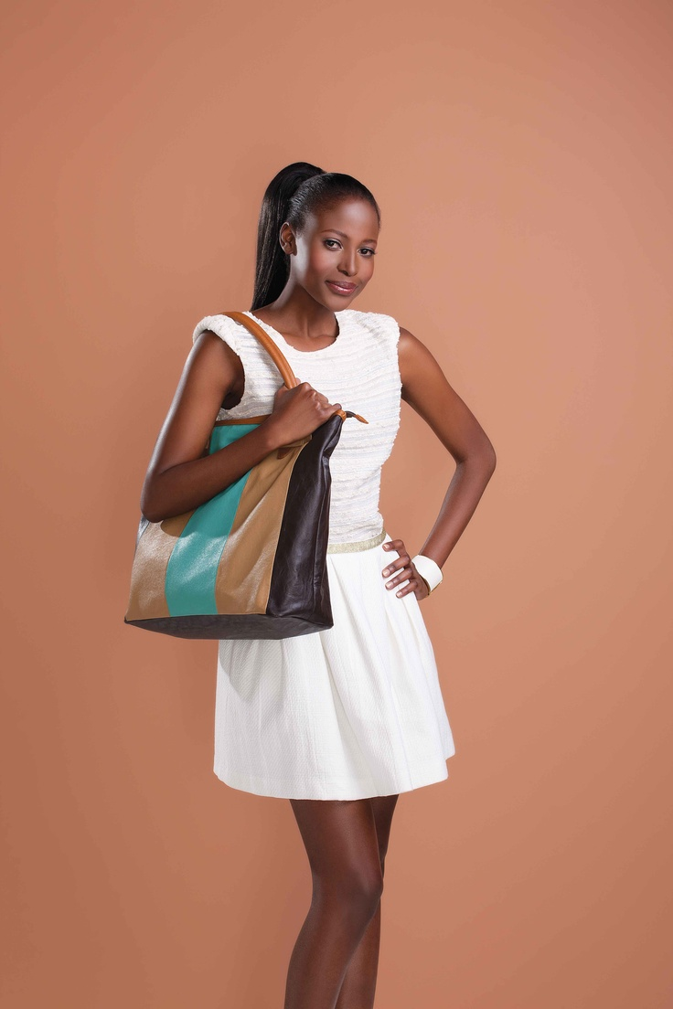 Get your trend on with the Chelsea Handbag. Vibrant and stylish, it's   sure to become an instant favourite.  Chelsea Handbag  PVC leather with lining.   38 cm L x 14.5 cm W x 36 cm H  Code 7286  For More Information - http://www.justine.co.za/PRSuite/home_page.page