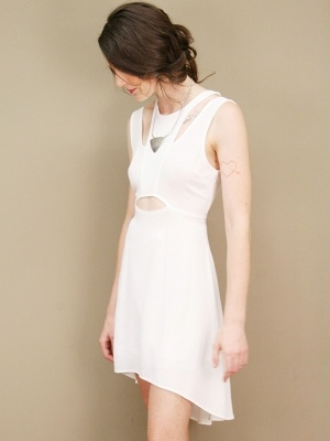 Slinky white dress with asymmetrical, fishtail hem, racer front, and cutout detail at shoulders, back and center bodice.