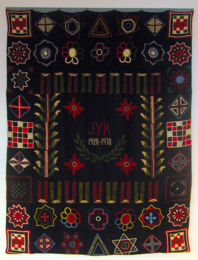 A rug from the 1970s, created by the alumni of a Finnish school
