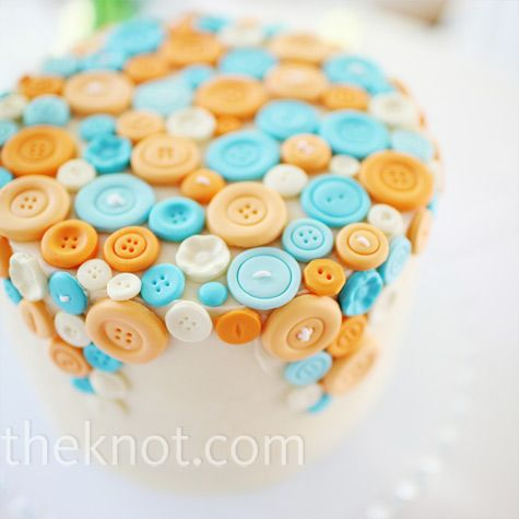 Serving double-duty as centerpieces as well, Kristen and Chris chose a variety of petite cakes decorated with buttons.