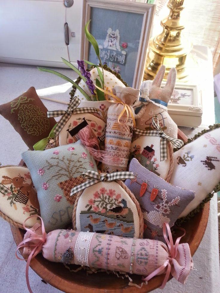 several spring cross stitch ornaments. pretty display