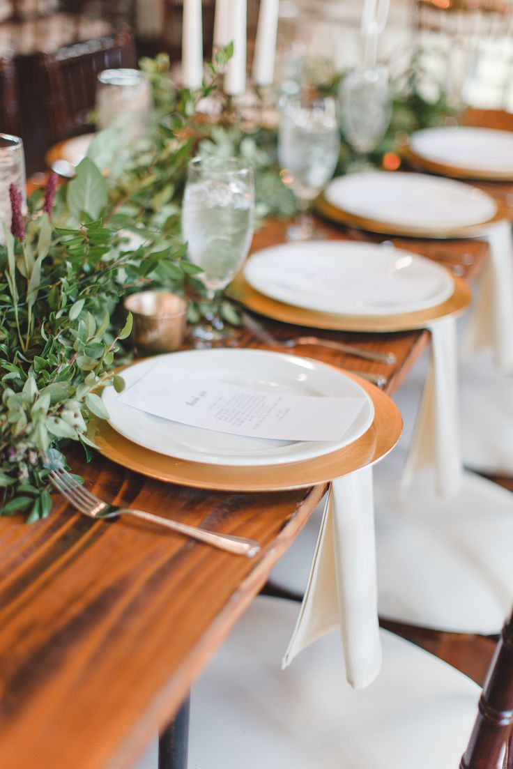 BRIK Venue | Lindsay Davenport Photography | Fort Worth | Wedding | Texas | DFW | Events Venue | Industrial | Warehouse | Reception | Wood Tables | Banquet Tables | Chiavari Chairs | Greenery | Candles | Gold Chargers | White Plates | Table Decor