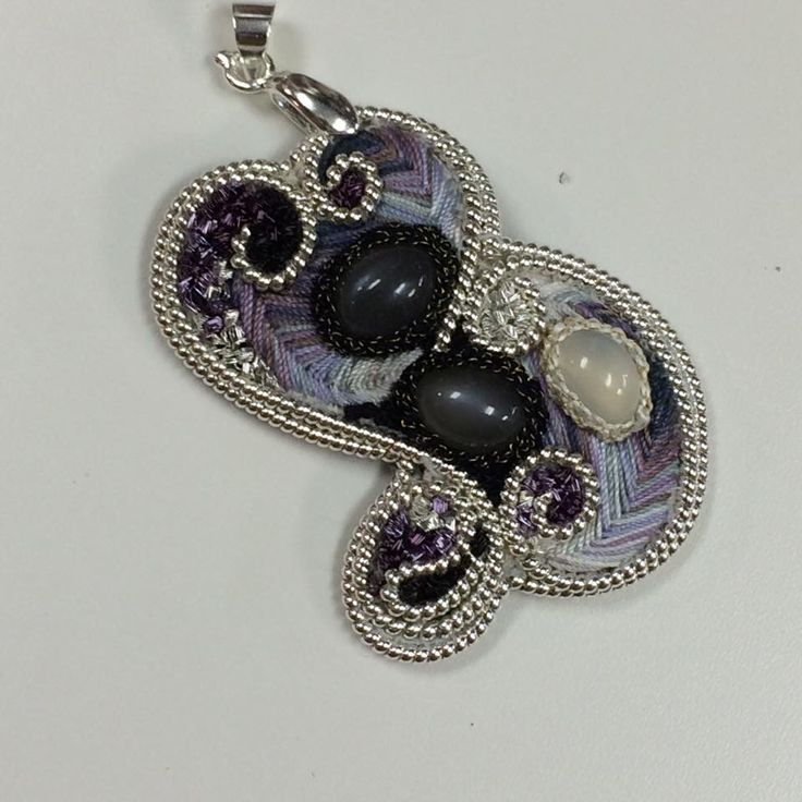 Moonstone, silk & silver embroidered pendant. #embroidery #jewellery #goldwork