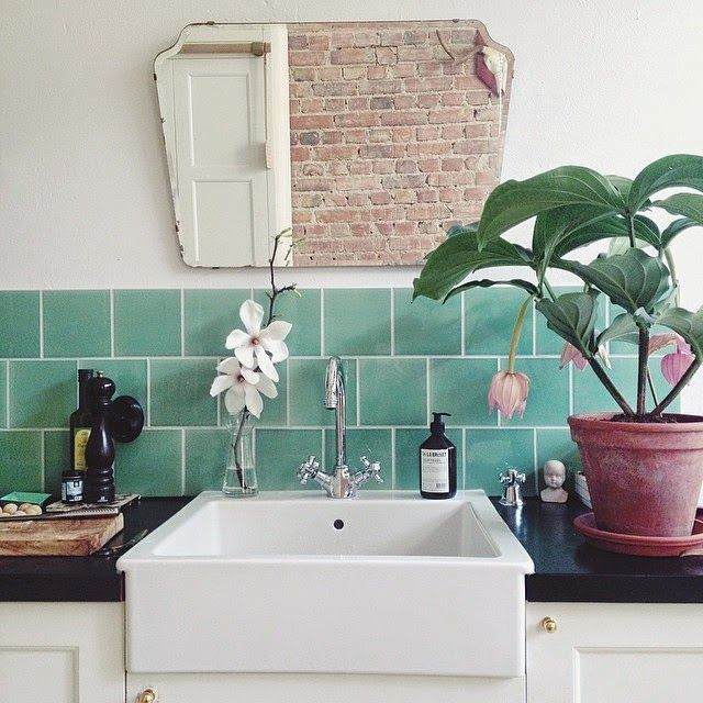 These bathroom tiles are fantastic! (Also: the vintage mirror, sink, exposed brick in the reflection, hardware, plant..........sooooo basically everything! ;) )