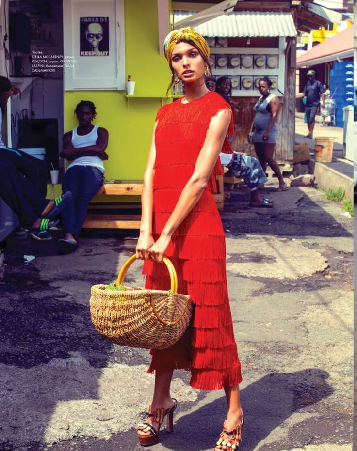 Traveling to the Caribbean, the July 2017 issue of ELLE Kazakhstan focuses on tropical style for this editorial. Photographer Daniela Rettore captures model Livia Rangel on the city streets in vibrant looks. Stylist Benedetta Ceppi dresses Livia in a mix of swimsuits, maxi skirts and fringed dresses. The brunette beauty captivates in the designs of...[Read More]