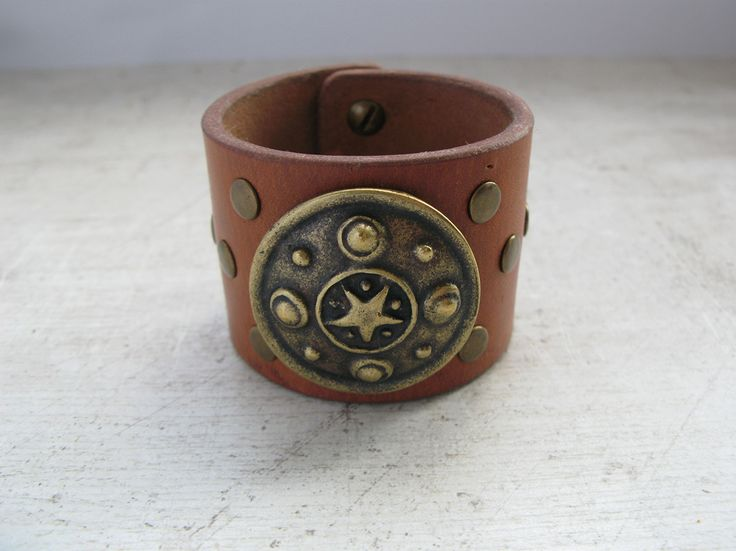 Leather bracelet with concho.