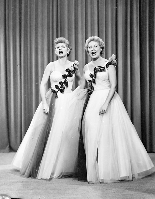 """I Love Lucy: Lucy and Ethel Buy the Same Dress (Season 3) -- The girls accidentally buy the same dress for a performance and both agree to go back to the store to exchange them. Needless to say, both go back on their word and surprise one another upon entering onto the stage (""""It's Friendship..."""")."""