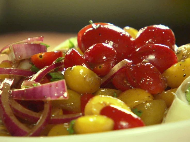 Quick-Marinated Cherry Tomato Salad Dressing. My mom and I made this last night and it was soooo good.  :)  Enjoy!!!