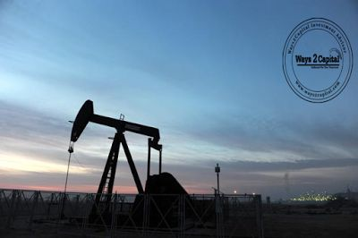Oil prices eased on Tuesday as traders began to unwind positions in the run-up to the year-end holiday season.