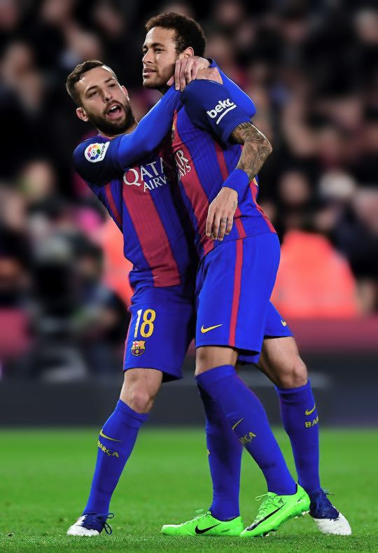 Neymar celebrates with his team mate Jordi Alba after scoring his team's fifth goal during the La Liga match between FC Barcelona and Real Sporting de Gijon at Camp Nou stadium on March 1, 2017 in Barcelona.