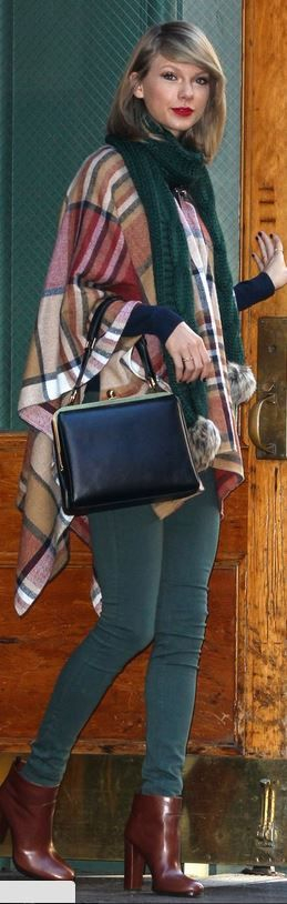 Who made Taylor Swift's black leather handbag, red plaid cape, pm scarf, and green skinny jeans?