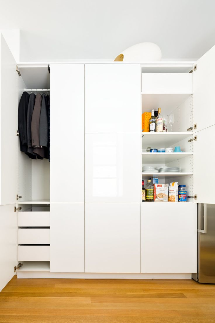 Elegant In the kitchen a single Sektion wardrobe from IKEA is used to stow both clothing