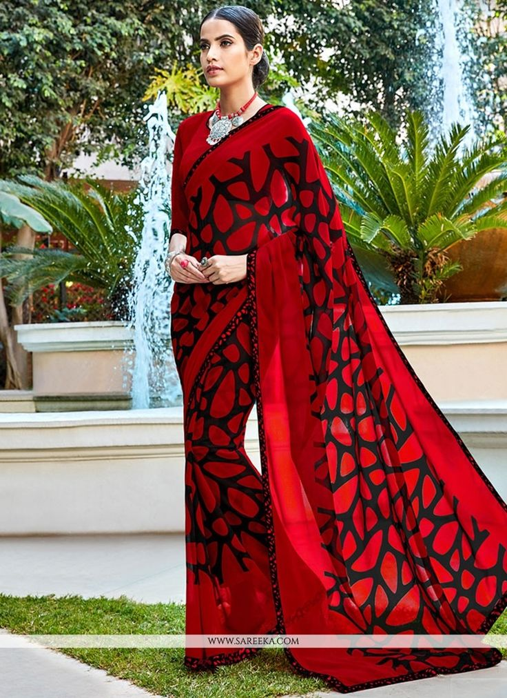 Authentic elegance comes out as a results of the dressing style with this red faux georgette printed saree. The ethnic digital print work with the attire adds a sign of splendor statement for the look...
