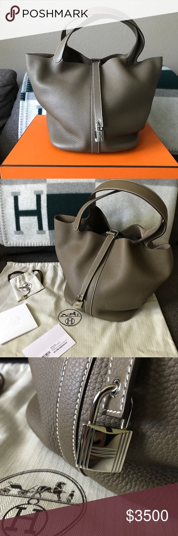 """Authentic Hermes Picotin Lock 26 ETOUPE Authentic Hermes Picotin Bag in large size 26 Gorgeous clemence leather in taupe grey color (ETOUPE) with white stitch details.  Rare find.  Brand New never worn out / Come with original dust bag, box, lock and keys.  Purchased at the Hermes store in Asia in July 2017.  Measurement 10"""" x 10"""" x 8.5"""" Made in France  Please ask all questions before making offer / purchasing. ** modeling photo was me holding the bag when purchased at the store. I'm 5'3""""…"""