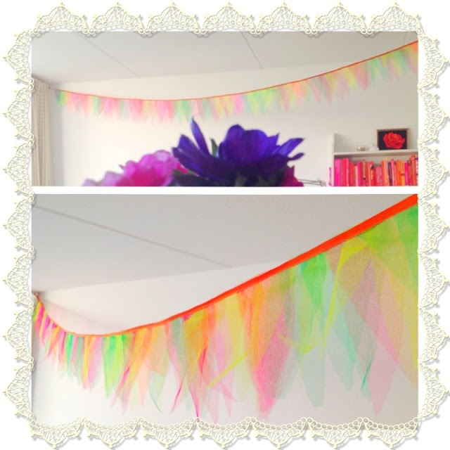 Lovely tule garland.  @Emily this would be fun to do with all the tutus you have!