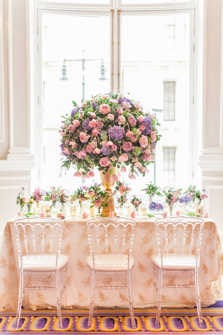 Beautiful pink and purple floral center piece. Flowers by Amie Bone Flowers. Luxury Wedding Inspiration From The Corinthia Hotel in London- ROCK MY WEDDING | UK WEDDING BLOG