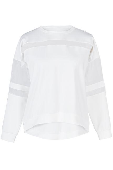 Klasyczna bluza w wersji białej z prześwitującymi wstawkami od #byorianne #bluza. Dostępna w naszym butiku #BoutiqueLaMode.Com.