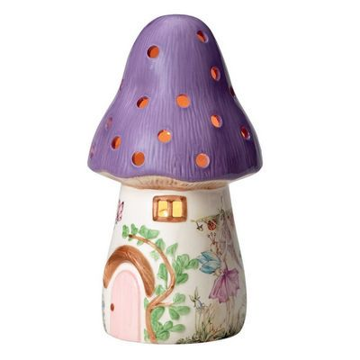 A beautiful Lamp the Dewdrop Toadstool Lamp is made from earthenware with hand painted accents. Gentle rays of light glow through windows and holes in the lamp.