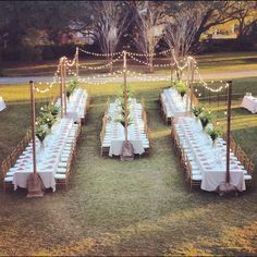 Outdoor Wedding with banquet style tables and string lights. Simple but elegant.