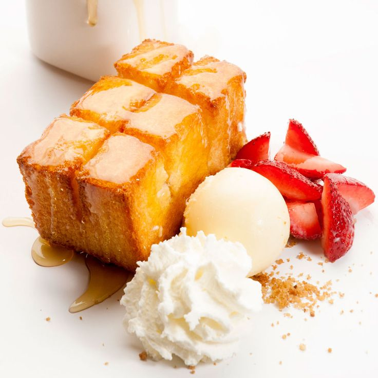Golden toast with condensed milk ice cream, drizzled honey and fresh strawberries from Spot Dessert Bar. http://www.spotdessertbar.com