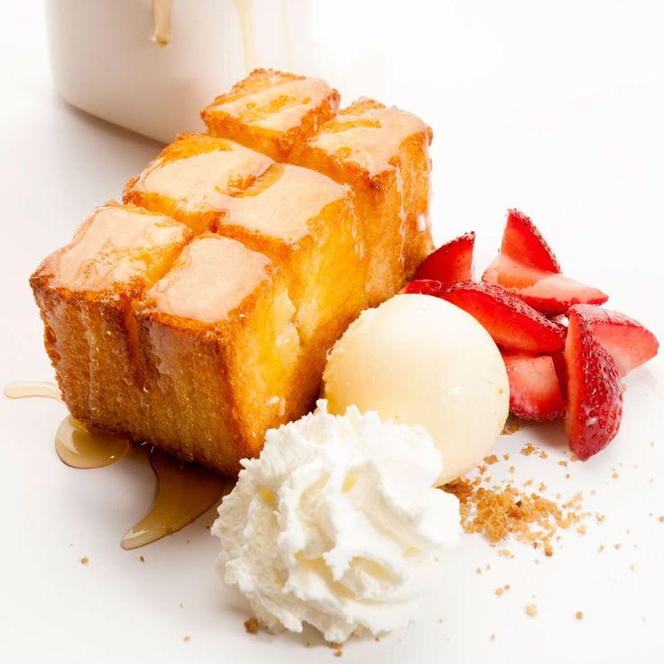 Golden toast with condensed milk ice cream, drizzled honey and fresh strawberries from Spot Dessert Bar. http://www.spotdessertbar.com