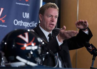 Shirts With Random Triangles: Bronco Mendenhall Cites BYU's Independent Status As Reason He Left To Become Virginia Head Coach.