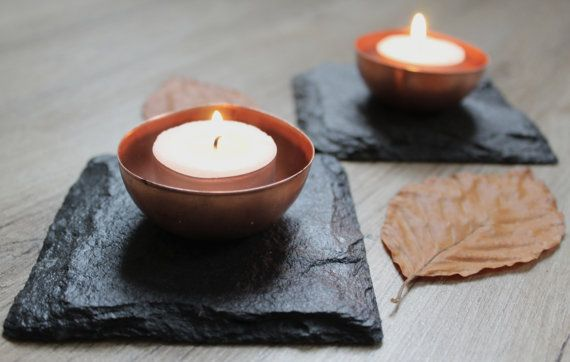 The copper and slate in this tea light holder complement each other beautifully. Buy one for a wonderful addition to your coffee table or a trio for a table centrepiece.  Sourced from the finest slate and hand cut in Cumbria by a craftsman with over 35 years experience.  The price includes 1 loose stylish egg shaped copper tea light holder and 1 tea light so you can use with or without. Each slate is unique in texture and cut and may vary slightly due to the natural geology of the slate…