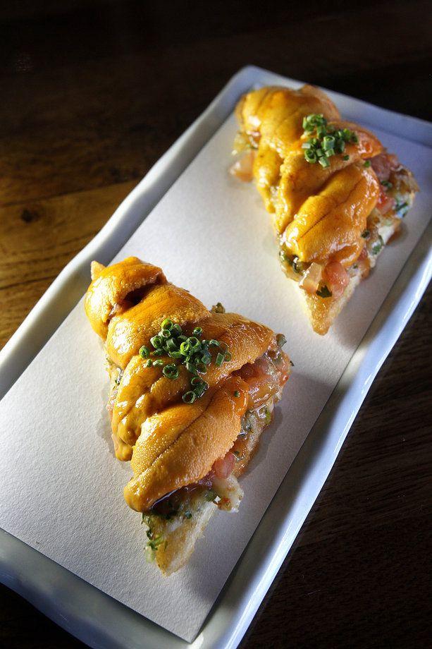 Paiche: Uni shrimp toast made with sea urchin, shrimp paste, and rocoto honey sauce. ( Christina House / For the Times )