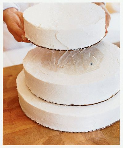 Step-by-step guide to making a simple, elegant wedding cake: the equipment you need, wedding cake assembly, cake-baking countdown, and recipes for Orange Sponge Cake with Grand Marnier Whipped Cream Frosting and Marmalade Filling.